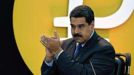 """Venezuela's President Nicolas Maduro gestures during a press conference to launch to the market a new oil-backed cryptocurrency called """"Petro"""", at the Miraflores Presidential Palace in Caracas, on February 20, 2018. Venezuela formally launched its new oil-backed cryptocurrency on Tuesday in an unconventional bid to haul itself out of a deepening economic crisis. The leftist Caracas government put 38.4 million units of the world's first state-backed digital currency, the Petro, on private pre-sale from the early hours. A total of 100 million Petros will go on sale, with an initial value set at $60, based on the price of a barrel of Venezuelan crude in mid-January.  / AFP PHOTO / Federico PARRA"""